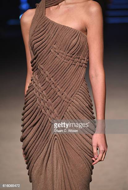 A model dress detail walks the runway at the Ezra show during Fashion Forward Spring/Summer 2017 at the Dubai Design District on October 21 2016 in...