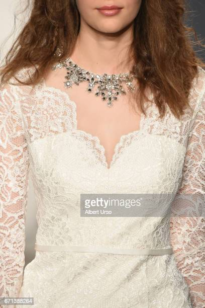 Model, dress detail, walks the runway at the Jenny Packham show during New York Fashion Week: Bridal on April 21, 2017 in New York City.