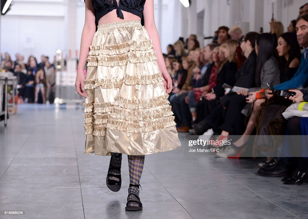 A model, dress detail, walks the runway at the Molly Goddard show during London Fashion Week February 2018 on February 17, 2018 in London, England.