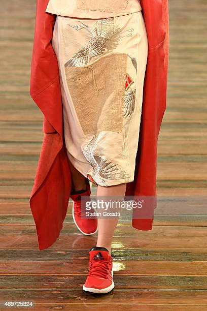 A model dress detail walks the runway during the Akira show at MercedesBenz Fashion Week Australia 2015 at Carriageworks on April 15 2015 in Sydney...