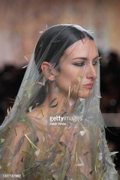 Model, dress details, walks the runway during the Christian Dior Haute Couture Fall/Winter 2021/2022 show as part of Paris Fashion Week on July 05,...