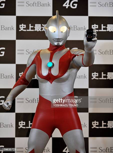 """Model dressed as the fictional action character Ultraman displays the """"Ultra Wi-Fi 4G"""" Wi-Fi router, featuring a maximum reception speed of 110..."""