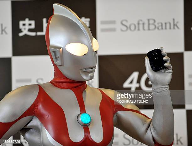A model dressed as the fictional action character Ultraman displays the 'Ultra WiFi 4G' WiFi router featuring a maximum reception speed of 110...