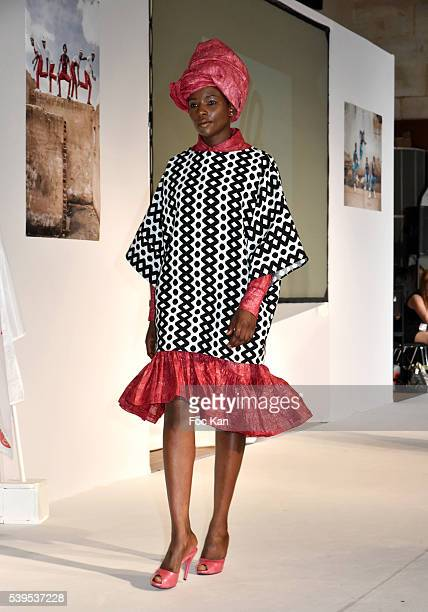 A model dressed by Alex Rotin walks the runway during Labo International 10th Edition African Ethnic and Sapeurs Fashion Show at Espace des Blancs...