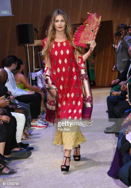 """Model dressed by Amal Sultana Khan walks the runway during the """"Paris Appreciation Awards 2017"""" At The Eiffel Tower on July 8, 2017 in Paris, France."""