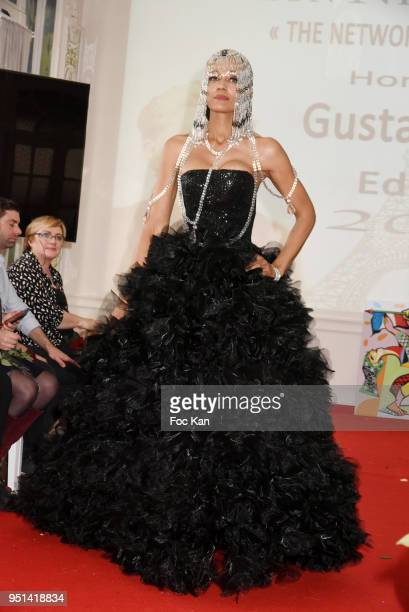 A model dressed by Dimitri Vincent Petit walks the Runway during 'Fashion Night Couture' 8th Edition at Galerie de Miroirs on April 25 2018 in Paris...