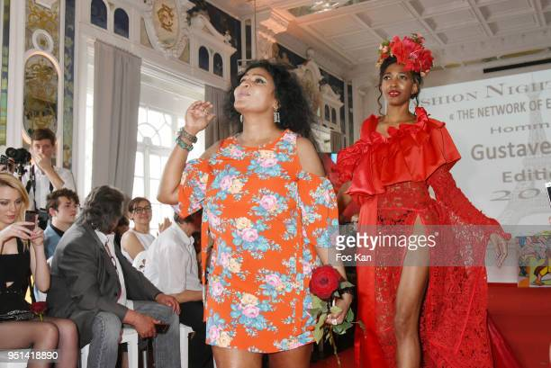 A model dressed by Enoka Fonseka walks the Runway during 'Fashion Night Couture' 8th Edition at Galerie de Miroirs on April 25 2018 in Paris France