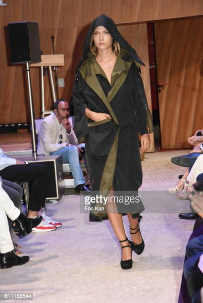 """Model dressed by InDgo Now by Ertan Seyhun walks the runway during the """"Paris Appreciation Awards 2017"""" At The Eiffel Tower on July 8, 2017 in Paris,..."""