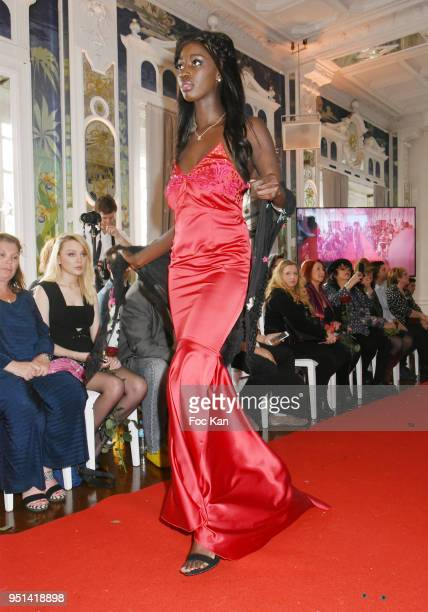 A model dressed by Isabelle Di Matteo walks the Runway during 'Fashion Night Couture' 8th Edition at Galerie de Miroirs on April 25 2018 in Paris...