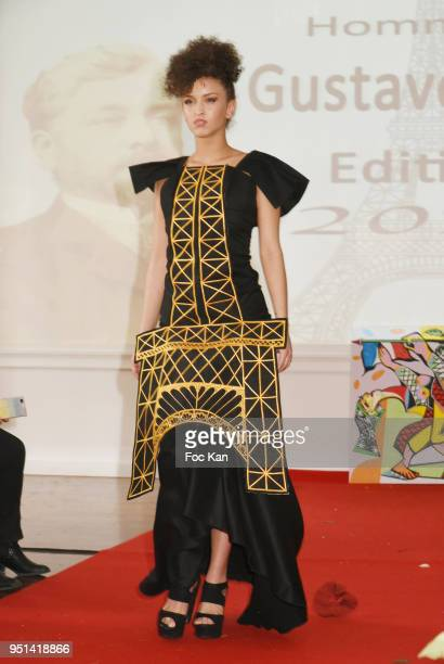 A model dressed by Marie France Vemabel walks the Runway during 'Fashion Night Couture' 8th Edition at Galerie de Miroirs on April 25 2018 in Paris...