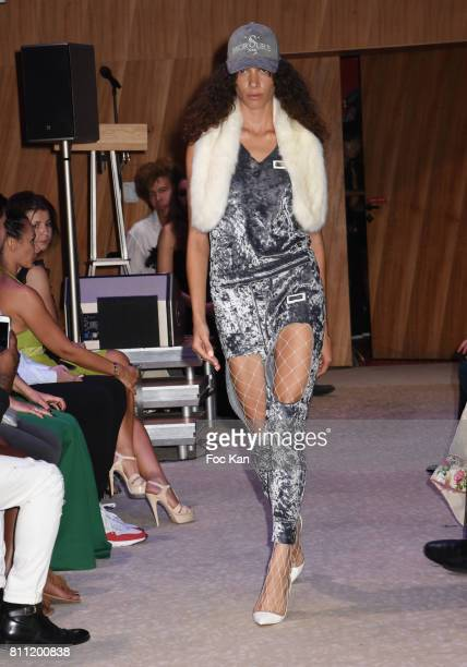 """Model dressed by Morsure walks the runway during the """"Paris Appreciation Awards 2017"""" At The Eiffel Tower on July 8, 2017 in Paris, France."""