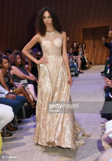 """Model dressed by Sublim Elle walks the runway during the """"Paris Appreciation Awards 2017"""" At The Eiffel Tower on July 8, 2017 in Paris, France."""