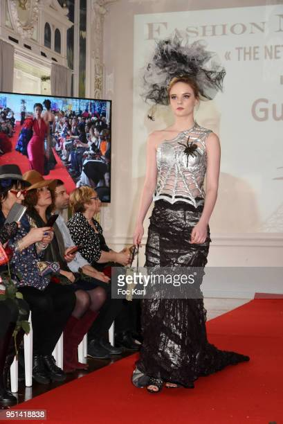 A model dressed by Tarquin Benel walks the Runway during 'Fashion Night Couture' 8th Edition at Galerie de Miroirs on April 25 2018 in Paris France