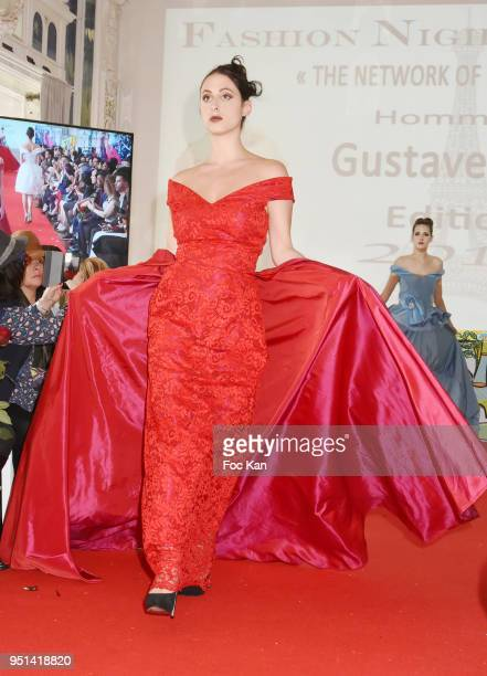 A model dressed by Tatiana Bevis walks the Runway during 'Fashion Night Couture' 8th Edition at Galerie de Miroirs on April 25 2018 in Paris France