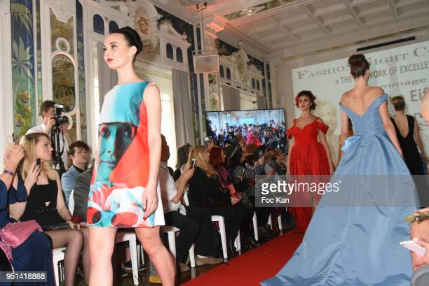 A model dressed by Veronique Fournier walks the Runway during 'Fashion Night Couture' 8th Edition at Galerie de Miroirs on April 25 2018 in Paris...