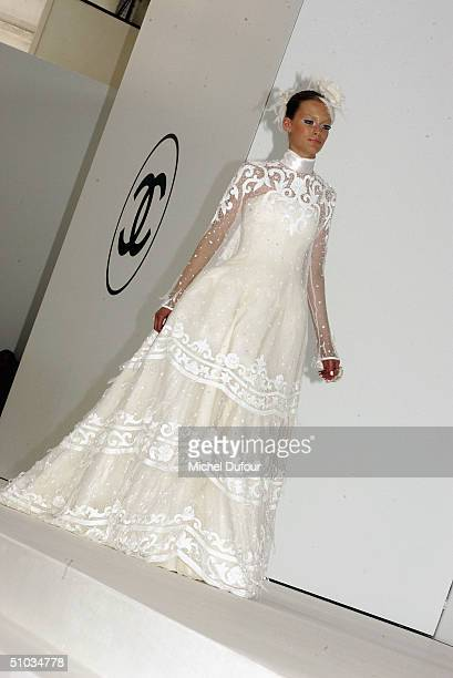 A model dressed in a brides dress at the Chanel Spring/Summer 2005 Fashion Show during Paris Fashion Week on July 7 2004 in Paris France