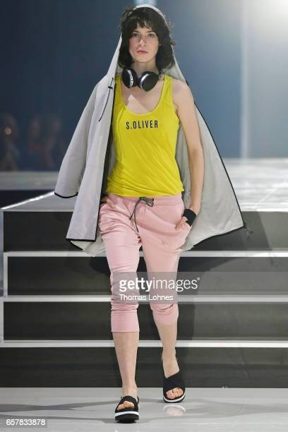 A model dressed in 'sOliver Red Label' walks the runway for 'sOliver THE FUSION COLLECTION Fashion Show' at Festhalle on March 25 2017 in Frankfurt...