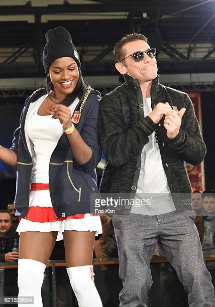 A model dressed in Winamax sportswear and Rap artist Kool Shen from NTM Band dance on the runway during the Winamax fashion show as part of Winamax...
