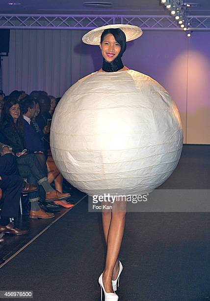 A model dressed with pieces of furniture walks the runway during 'Habitat' Celebrates Its 50th Anniversary at Habitat Pont Neuf on October 9 2014 in...