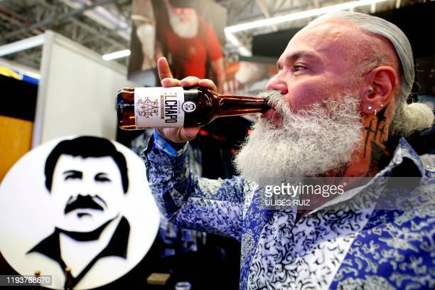 """Model drinks a beer of """"El Chapo 701,"""" a line in clothing, jewelry and liquor bearing the nickname of the jailed Mexican drug lord Joaquin """"El Chapo""""..."""