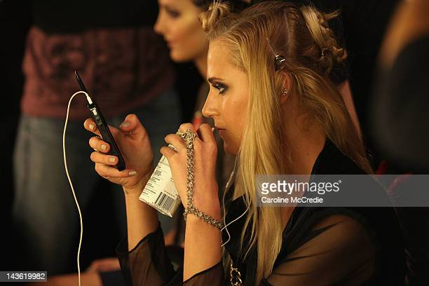 A model drinks coconut water backstage ahead of the By Johnny show on day two of MercedesBenz Fashion Week Australia Spring/Summer 2012/13 at...