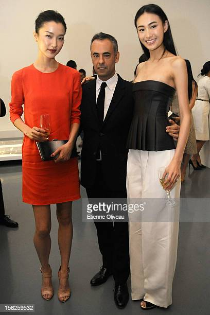 Model Du Juan Women's Creative Director of Calvin Klein Francisco Costa and Supermodel Qin Shu Pei pose for pictures during the Calvin Klein special...