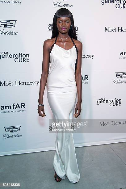 Model Duckie Thot attends the 2016 amfAR GenerationCure holiday party at Cadillac House on December 7 2016 in New York City