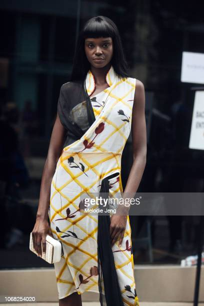 Model Duckie Thot wears a yellow floral dress after the Monse show during New York Fashion Week Spring/Summer 2019 on September 7 2018 in New York...
