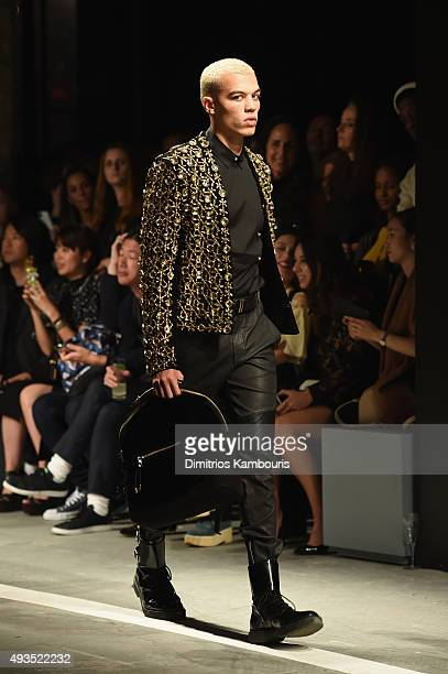 Model Dudley O'Shaughnessy walks the runway at the BALMAIN X HM Collection Launch at 23 Wall Street on October 20 2015 in New York City