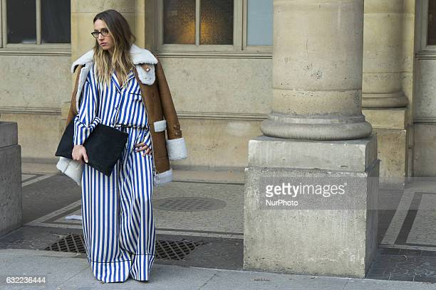 A model during Paris Fashion Week Menswear Fall/Winter 2017/2018 outside the Palais Royal on January 19 2017 in Paris France
