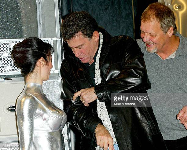 A model during the photoshoot accidently rubs the silver body paint she is wearing onto Paul Michael Glaser's jacket who then storms off whilst David...