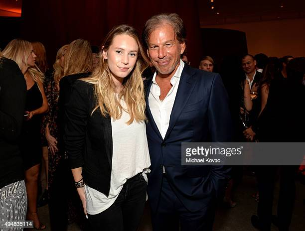 Model Dylan Penn and RH Chairman and CEO Gary Friedman celebrate with RH Restoration Hardware for the unveiling of 'Rain Room' by Random...
