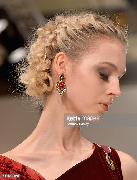 A model earring detail walks the runway at the Rohmir show at Fashion Scout during London Fashion Week Autumn/Winter 2016/17 at Freemasons' Hall on...