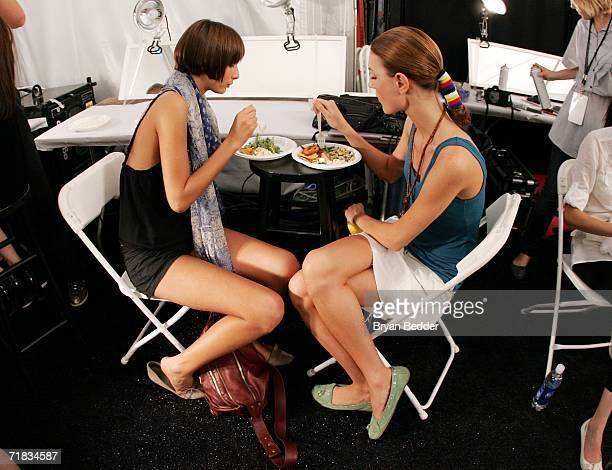 Model eat backstage at Alexandre Herchovitch Spring 2007 fashion show during Olympus Fashion Week at Bryant Park in The Tent September 9 2006 in New...