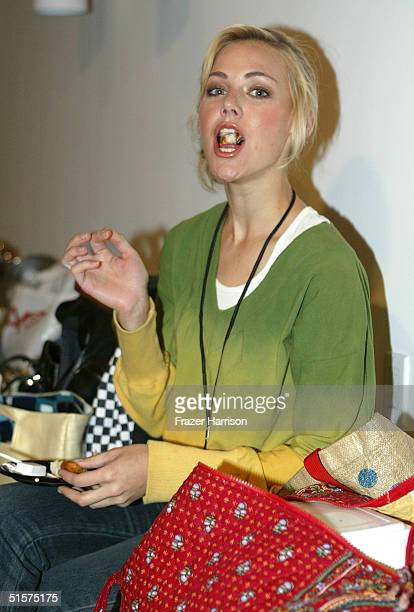 A model eats backstage at the Saja Collection Spring 2005 show at the MercedesBenz Fashion Week at Smashbox Studios October 26 2004 in Culver City...