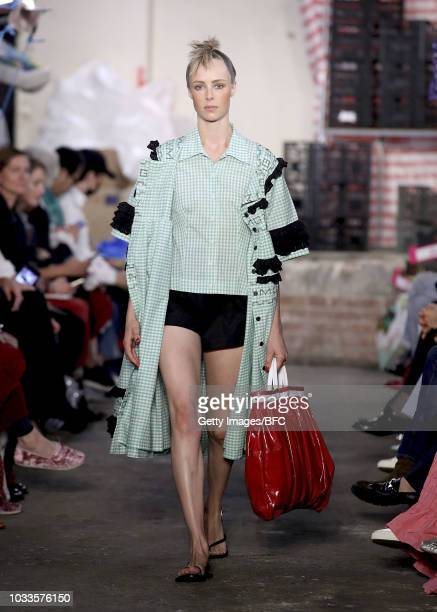 Model Edie Campbell walks the runway and opens the Molly Goddard show during London Fashion Week September 2018 at 26 Tavistock Street on September...