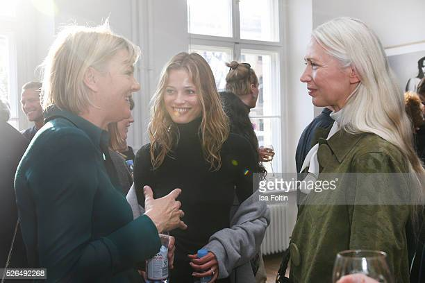 Model Edita Vilkeviciute and Christiane Arp chief editor Vogue Germany at 'Der Berliner Fotografie Salon Edition 1' on April 29 2016 in Berlin Germany