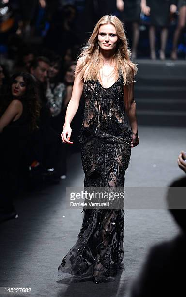 Model Edita Vilkeviciute walks the runway the 2012 amfAR's Cinema Against AIDS during the 65th Annual Cannes Film Festival at Hotel Du Cap on May 24...