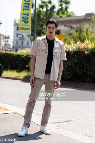 Model Edoardo Sebastianelli wears a tan jacket, khaki pants, and white Nike sneakers after the Pal Zileri show during the Milan Men's Fashion Week...