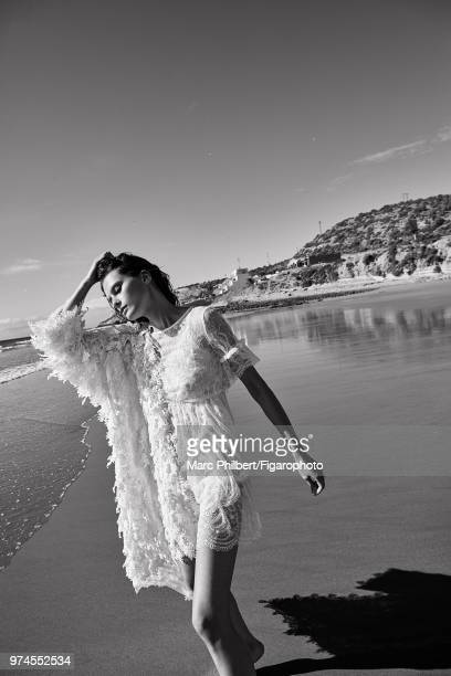 Model Elena Melnik poses at a fashion shoot for Madame Figaro on November 28 2017 in Taghazout Morocco Dress by LiuJo coat by Ermanno Scervino...