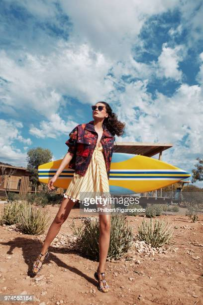 Model Elena Melnik poses at a fashion shoot for Madame Figaro on November 29 2017 in Taghazout Morocco Jacket dress Sunglasses sandals PUBLISHED...