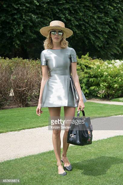 Model Elena Perminova wearing Dior day 2 of Paris Haute Couture Fashion Week Autumn/Winter 2014 on July 7 2014 in Paris France