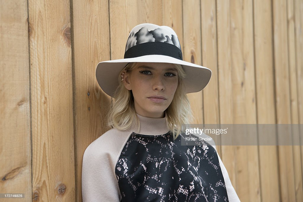 Model Elena Perminova wears a Louis Vuitton top and a Maison Michel hat on day 4 of Paris Collections: Womens Haute Couture on July 04, 2013 in Paris, France.