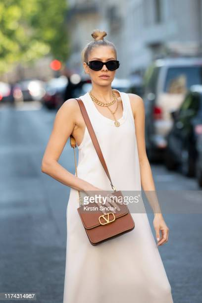 Model Elena Perminova wears all Valentino with Jimmy Choo sunglasses on July 03 2019 in Paris France