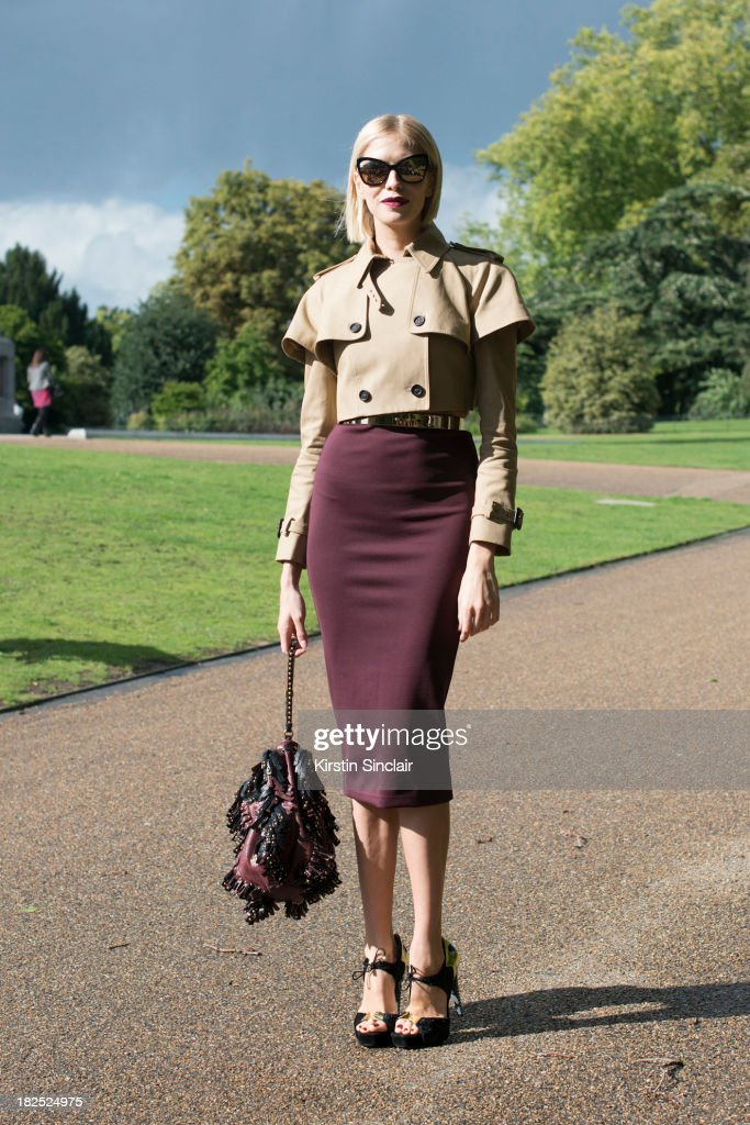 Model Elena Perminova wears Chanel sunglasses, Burberry jacket and bag, Aperlai shoes , skirt, top and belt from H and M on day 4 of London Fashion Week Spring/Summer 2013, at Somerset House on September 16, 2013 in London, England.