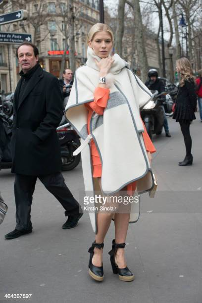 Model Elena Perminova wears Chloe shoes, dress and jacket day 2 of Paris Haute Couture Fashion Week Spring/Summer 2014, on January 21, 2014 in Paris,...