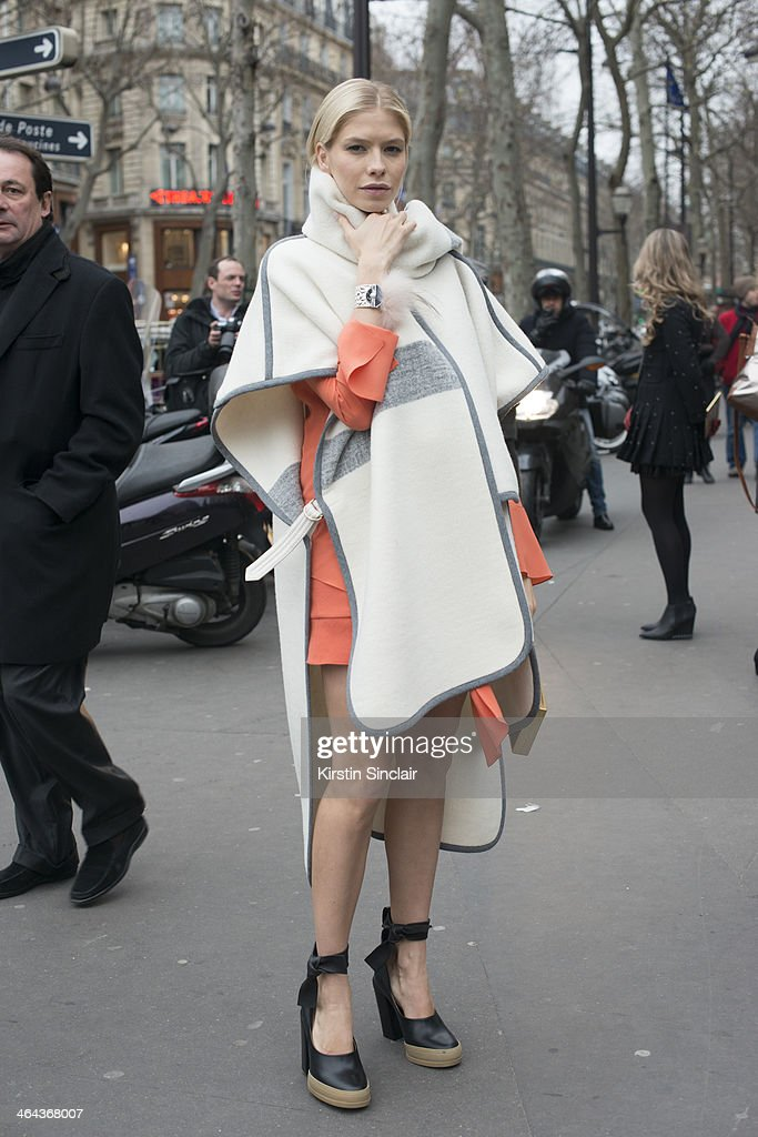 Model Elena Perminova wears Chloe shoes, dress and jacket day 2 of Paris Haute Couture Fashion Week Spring/Summer 2014, on January 21, 2014 in Paris, France.
