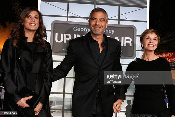 Model Elisabetta Canalis actor George Clooney and his mother Nina Warren arrive at the Los Angeles premiere of Up In The Air at Mann Village Theatre...