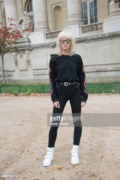 Model Elise Agee wears a Forever21 sweater HM jeans and Dr Martens trainers day 3 of Paris Womens Fashion Week Spring/Summer 2018 on September 28...