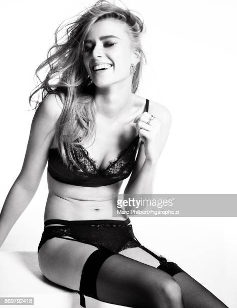 Model Elise Pluvinage poses at a fashion shoot for Madame Figaro on September 19 2017 in Paris France Lingerie earring and rings stockings PUBLISHED...